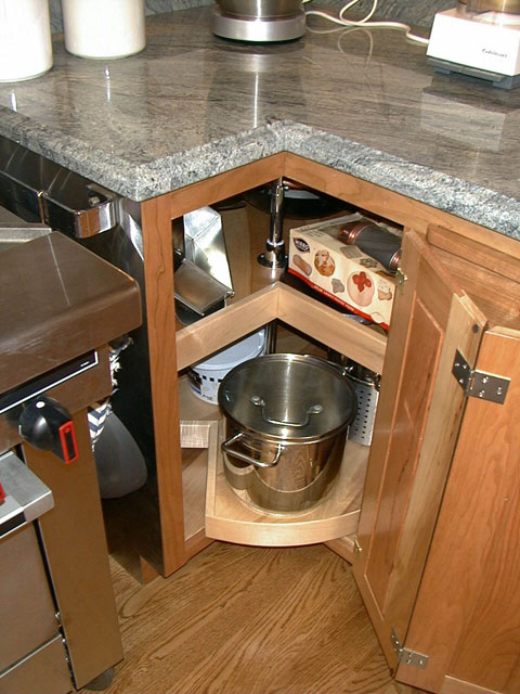 The Corner Base Cabinets Have Lazy Susan Inserts That Allows You Find  Things In The Back.